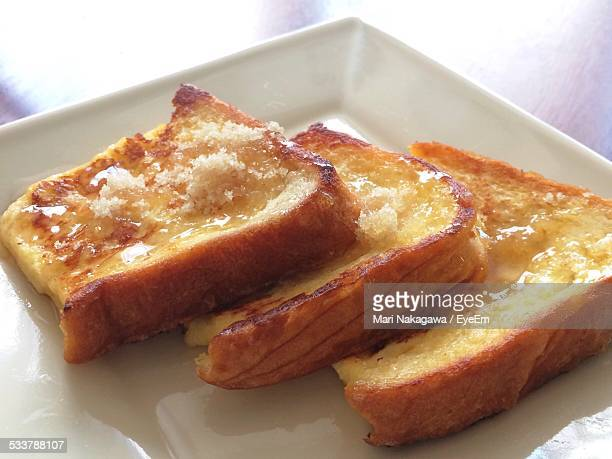Close-Up Of Toasted Bread Slices With Cheese