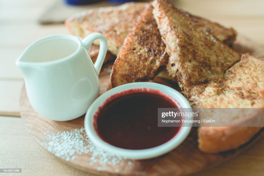 Close-Up Of Toasted Bread With Dip In Bowl Served On Table : Stock Photo