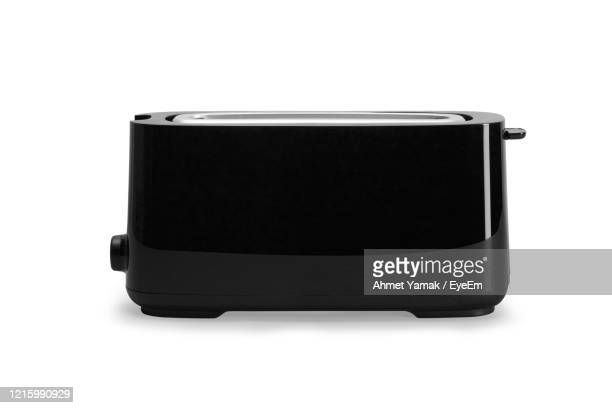 close-up of toaster against white background - toaster appliance stock pictures, royalty-free photos & images