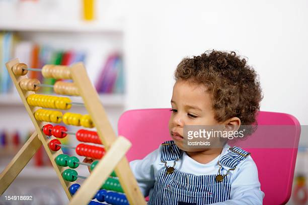 Close-up Of Toddler Playing With An Abacus