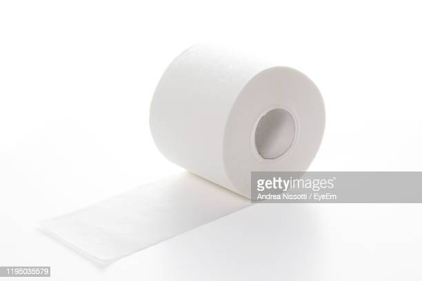 close-up of toilet paper over white background - トイレットペーパー ストックフォトと画像