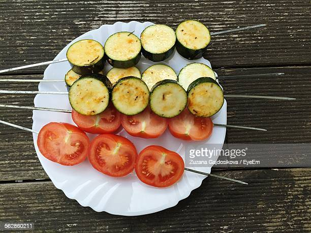 Close-Up Of Tomato And Zucchini Skewers Served On Table
