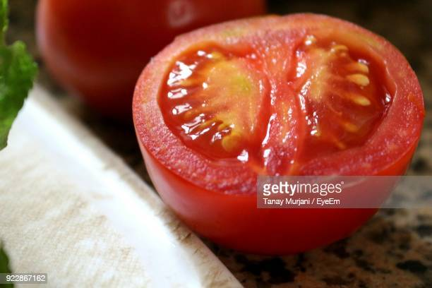 Close-Up Of Tomato Slice On Marble