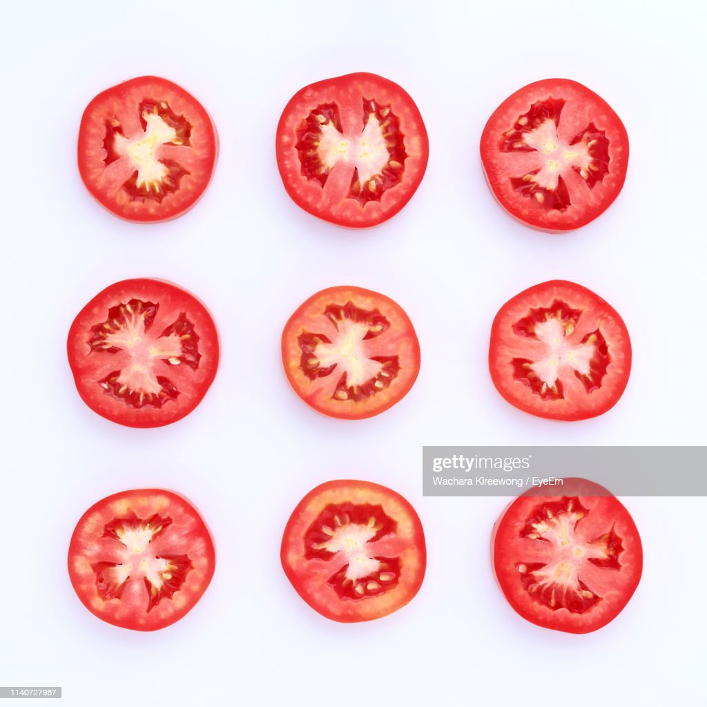 Close-Up Of Tomato Slices Against White Background : Stock Photo