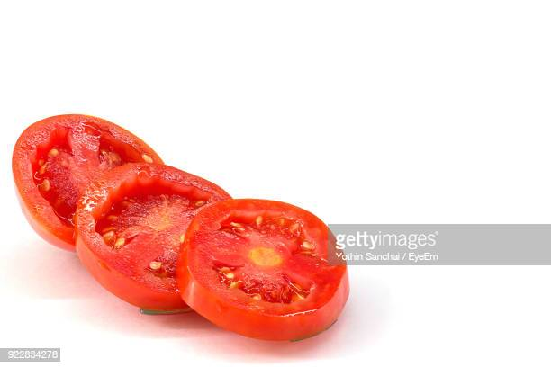 Close-Up Of Tomato Slices Over White Background