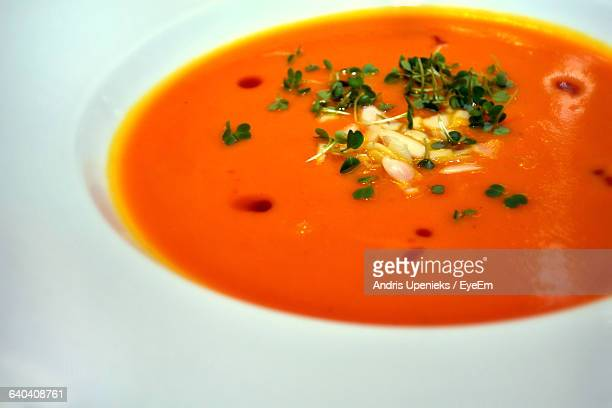 Close-Up Of Tomato Soup Served On White Background