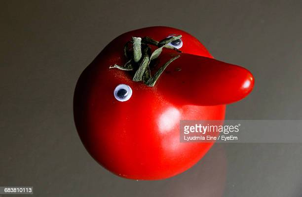 Close-Up Of Tomato With Nose