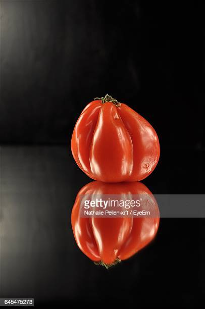 close-up of tomato with reflection - nathalie pellenkoft stock pictures, royalty-free photos & images