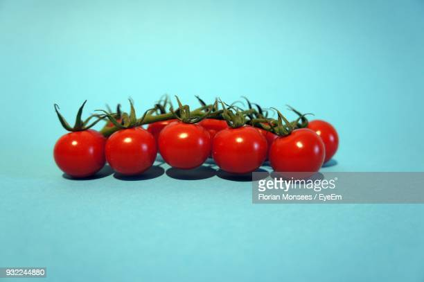 Close-Up Of Tomatoes Against Blue Background