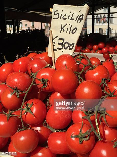 Close-Up Of Tomatoes At Market Stall With Price Tag