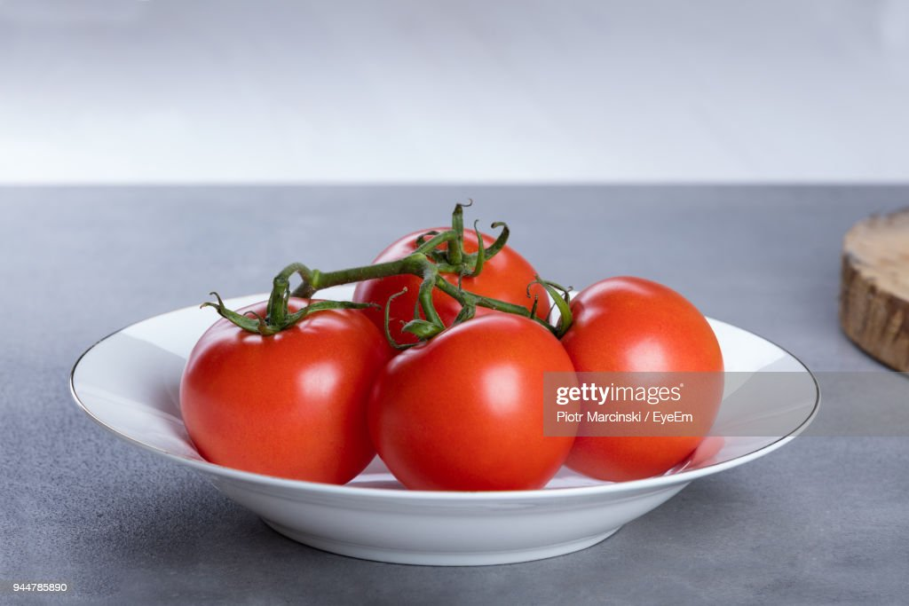 Close-Up Of Tomatoes In Plate On Table : Stock Photo
