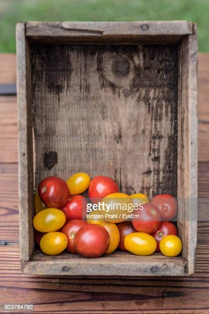 Close-Up Of Tomatoes In Wooden Crate On Table