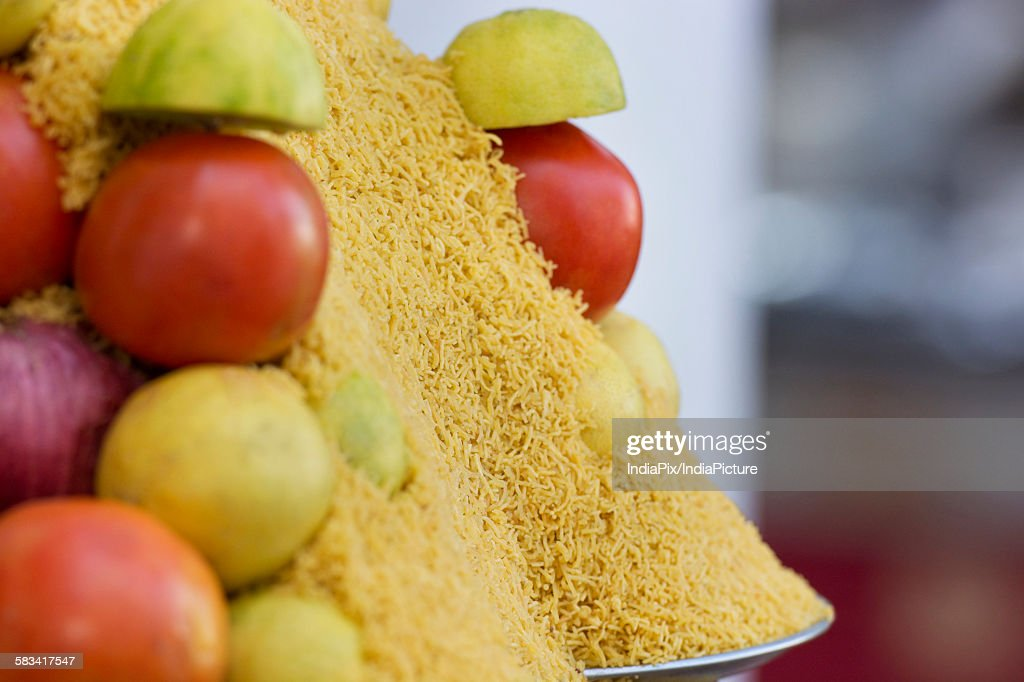 Close-up of tomatoes, onion,lemon and sev at street food stand : Stock Photo