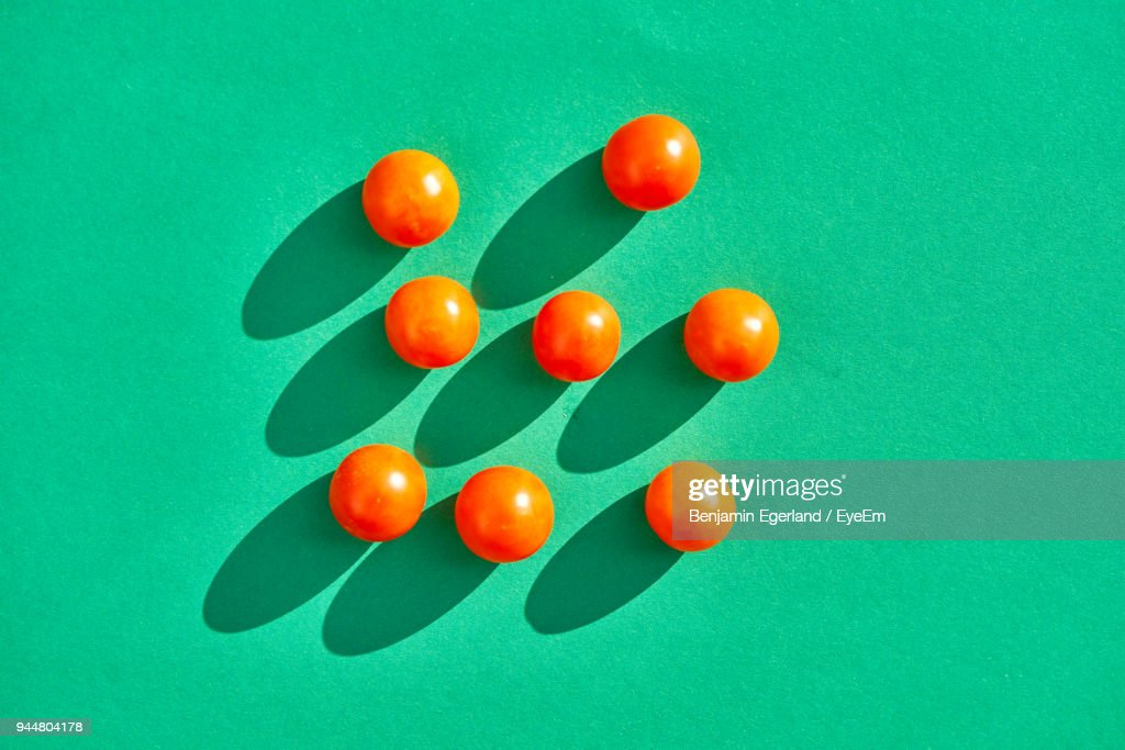 Close-Up Of Tomatoes Over Green Background : Stock Photo