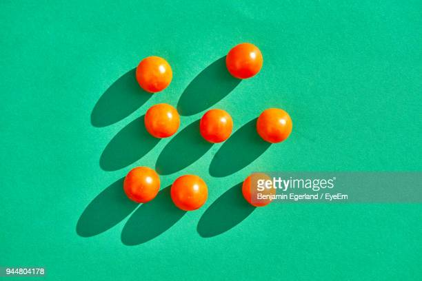 Close-Up Of Tomatoes Over Green Background