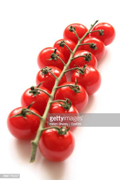 Close-Up Of Tomatoes Over White Background