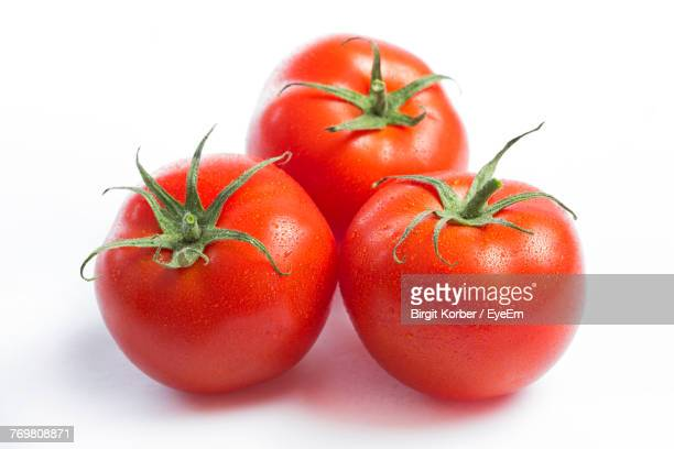 close-up of tomatoes over white background - トマト ストックフォトと画像