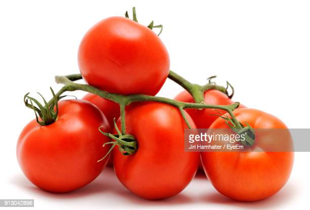 close-up of tomatoes over white background - tomato stock pictures, royalty-free photos & images