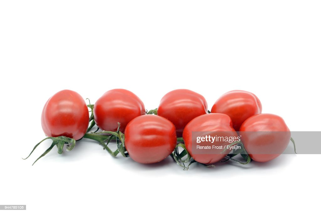Close-Up Of Tomatoes Over White Background : Stock Photo