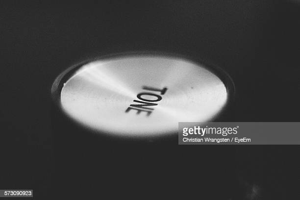 Close-Up Of Tone Text On Guitar Knob