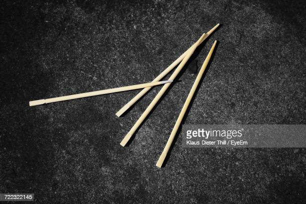 Close-Up Of Toothpicks On Black Table