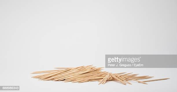 Close-Up Of Toothpicks Pile On White Background