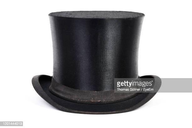 close-up of top hat against white background - top hat stock pictures, royalty-free photos & images
