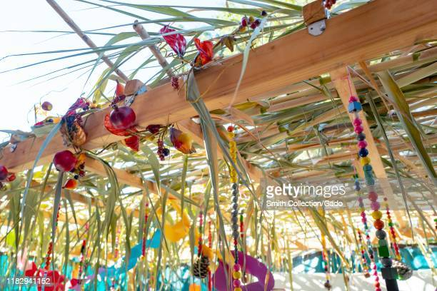 Close-up of top of a Sukkah, a temporary outdoor hut constructed and occupied during the Jewish high holiday of Sukkot, symbolic of the temporary...