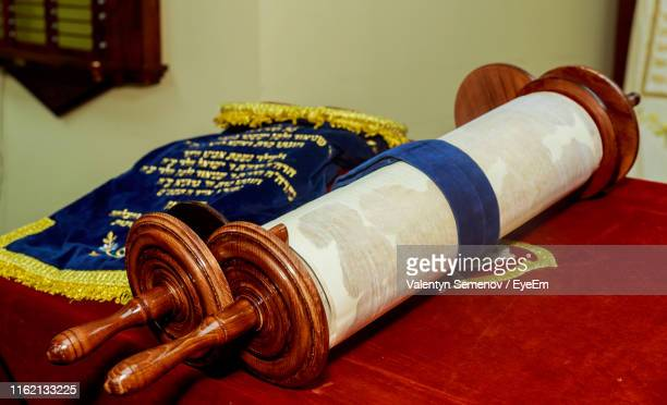 close-up of torah scroll on table - jewish prayer shawl stock pictures, royalty-free photos & images
