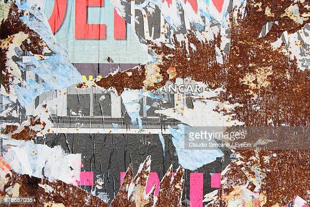 Close-up Of Torn Poster On Wall