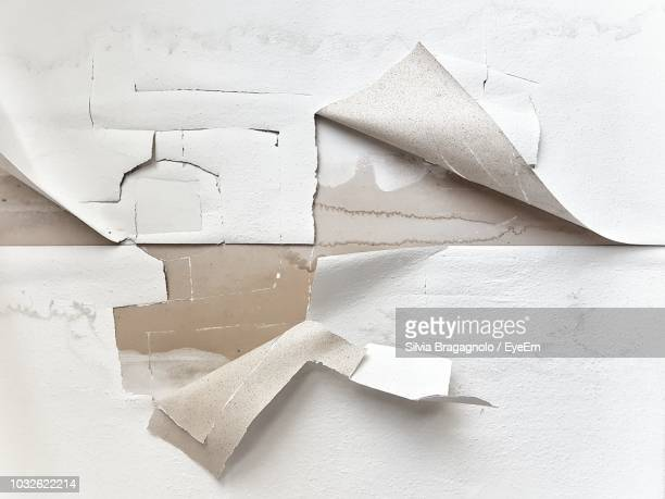 close-up of torn wallpaper - peeling off stock photos and pictures