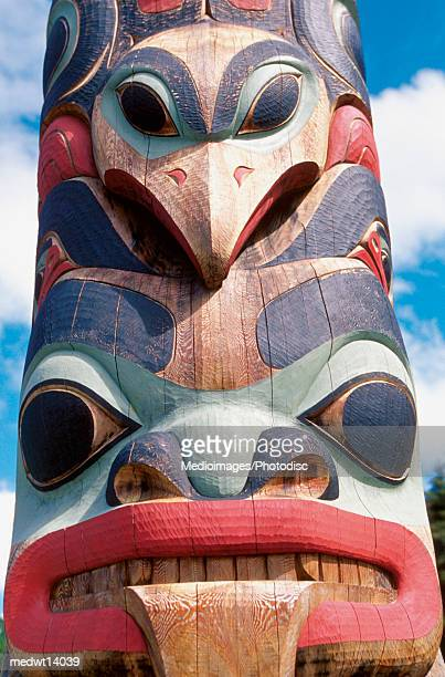 close-up of totem pole in sitka, alaska, usa - totem pole stock photos and pictures
