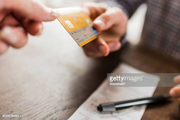 Close-up of tow hands with credit card