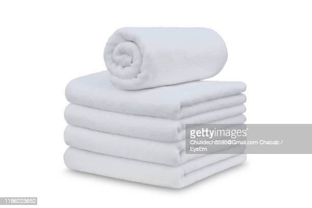 close-up of towels against white background - タオル ストックフォトと画像