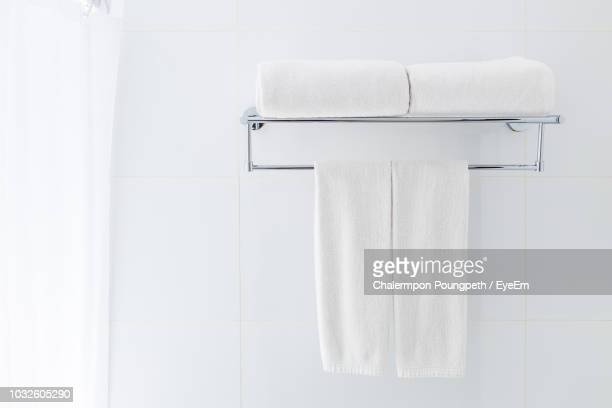 close-up of towels and napkins on rack in bathroom - タオル ストックフォトと画像