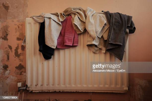 close-up of towels drying against wall - alessandro miccoli stockfoto's en -beelden
