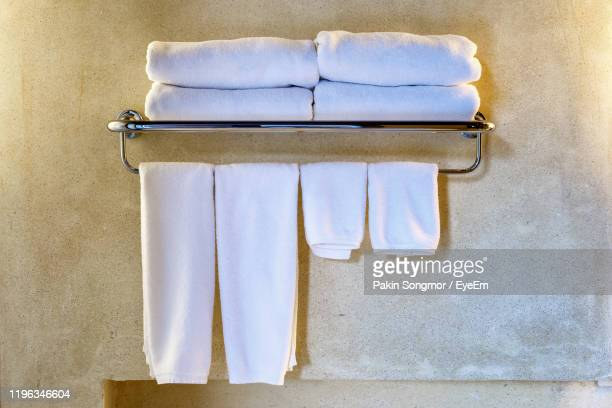close-up of towels hanging against wall - towel stock pictures, royalty-free photos & images
