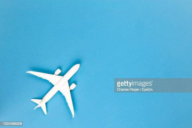 close-up of toy airplane against blue background - still life not people stock photos and pictures