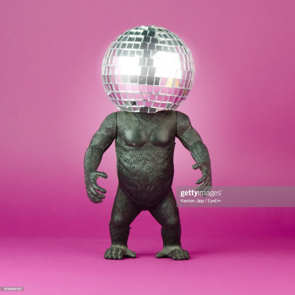 Close-Up Of Toy Animal With Disco Ball Against Pink Background : Stock Photo
