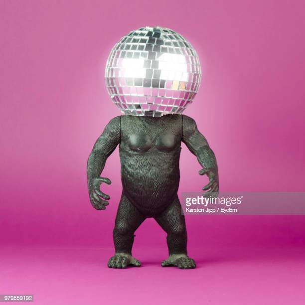 Close-Up Of Toy Animal With Disco Ball Against Pink Background