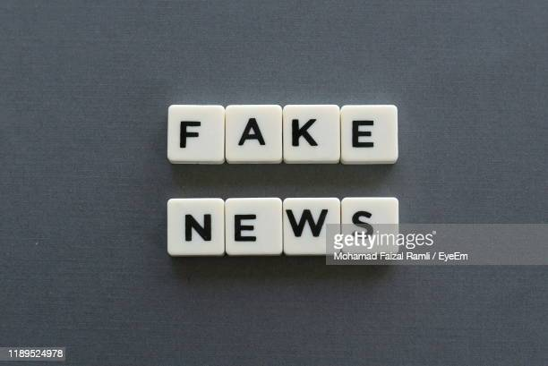 close-up of toy blocks on table - fake news foto e immagini stock