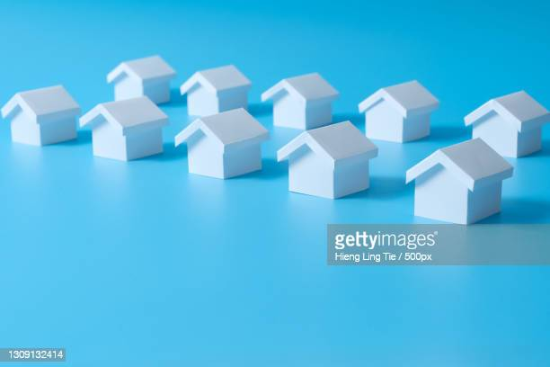 close-up of toy blocks over blue background - mortgage stock pictures, royalty-free photos & images