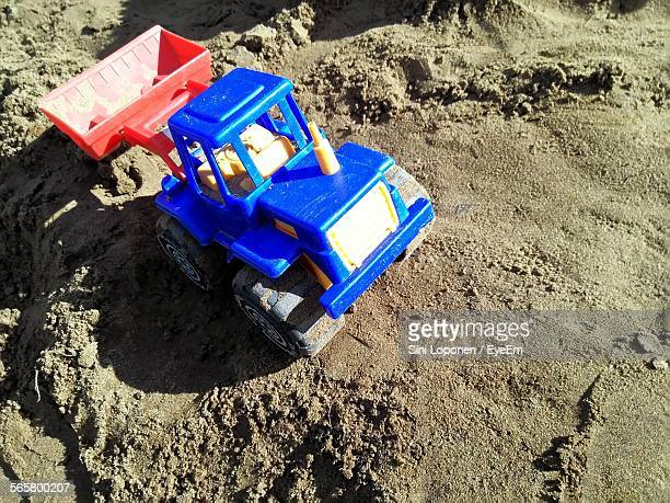 Close-Up Of Toy Bulldozer In Sand