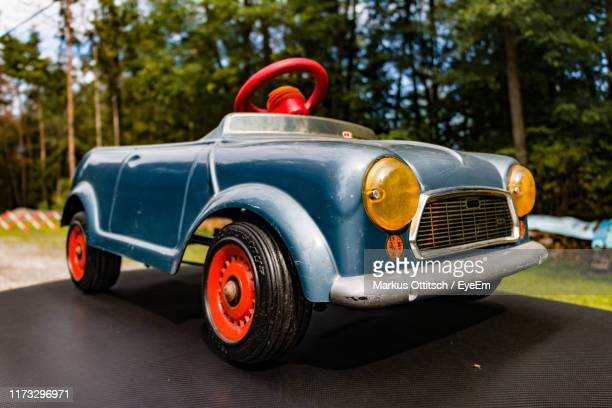 close-up of toy car on road - antique stock pictures, royalty-free photos & images
