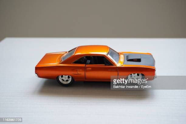 close-up of toy car on table - toy car stock pictures, royalty-free photos & images