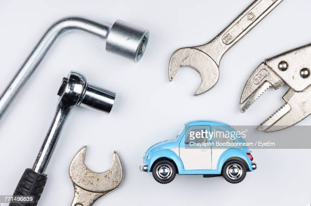 close-up of toy car with work tools on white background - toy car stock pictures, royalty-free photos & images