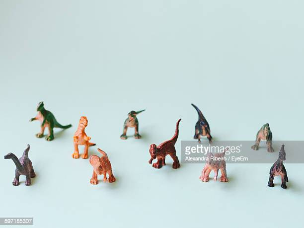 close-up of toy dinosaurs on white background - toy animal stock photos and pictures