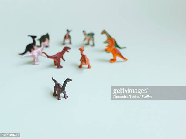 Close-Up Of Toy Dinosaurs On White Background