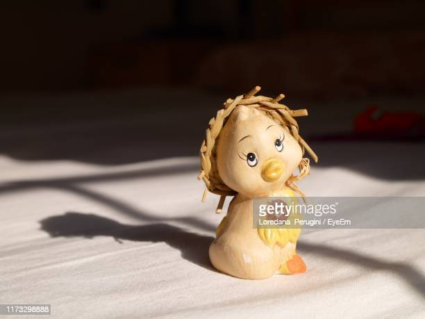 close-up of toy on bed - loredana perugini stock pictures, royalty-free photos & images