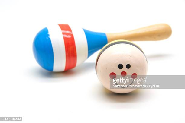 close-up of toy rattle - toy rattle stock pictures, royalty-free photos & images